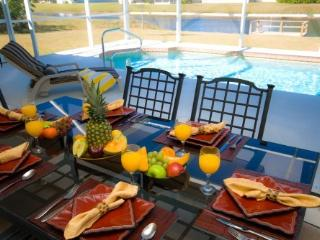 Alfresco dining overlooking the pool & waterway at Glorious Gulf Villa.