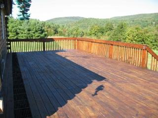 Deck overlooking view includes patio table and chairs