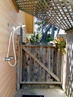 Outdoor shower with hot water, perfect for rinsing sand off kids after the beach