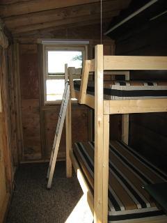 Side sleep porch has a bunk beds.. Kids love it.