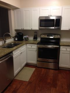 Newly remodeled kitchen, with new cabinets, granite counter tops and new stainless steel appliances