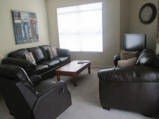Elegant chocolate brown leather sofa, loveseat, adjustable lounger living room