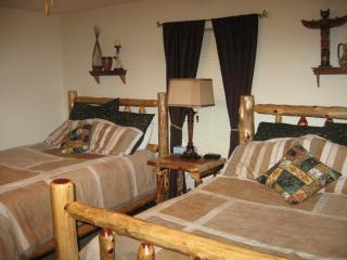 Two Queen Beds in the other main floor bedroom with full bath