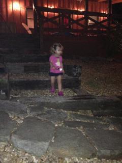 Cara walking to the campfire
