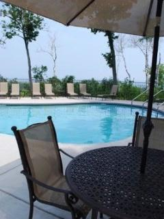 An Outdoor pool and deck-One of Three
