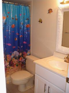 Second bathroom with tub and shower