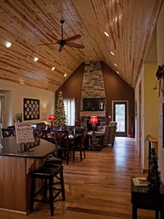 Large great room.  Hickory celings and hand scraped hickory floors add a lot!!