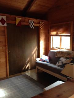 Loft with full futon, and Sleepy's comfort cot