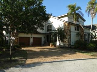 Impressive front of home with paved drive for 4 large vehicles
