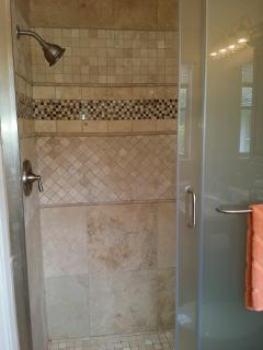 Full size walk-in shower in master suite with all travertine stone!