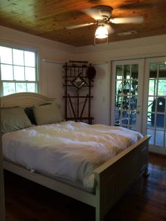 Bedroom with walk out to screen porch.  Flat screen t.v. and plenty of movies!