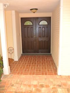 Entry door, brick driveway and entry.