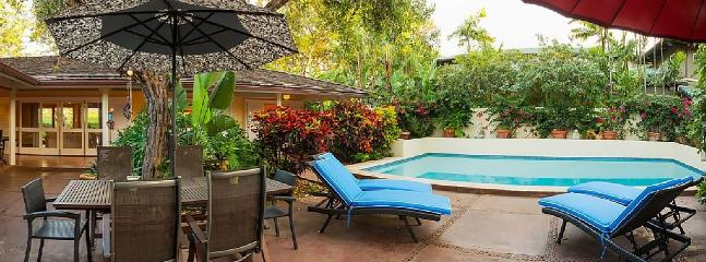 Pool area with lounge chairs
