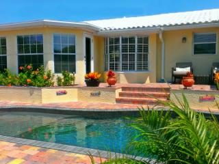 Pura Vida Oasis - 5BR Waterfront, Heated Pool, Spa near Village/Beach, Sleeps 13