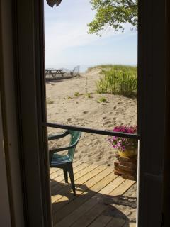 Front door leads to deck and beach area.