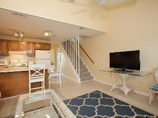 Downstairs living with Samsung LCD TV and DVD player.  Staircase to bedrooms
