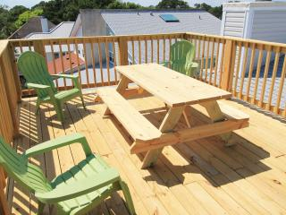 Deck Picnic Table and 6 Adirondack Chairs (3 shown)