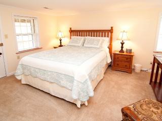 Spacious queen bedroom, beautiful oak furnishings, direct porch access