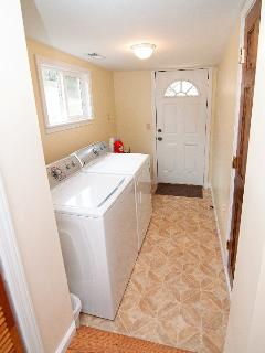 Laundry room, high-efficiency washer, dryer, exit to deck and gas grill