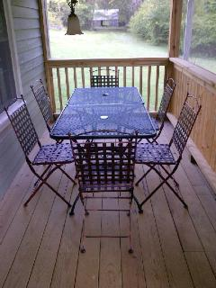 Also, enjoy outdoor dining for 6 on the screened porch