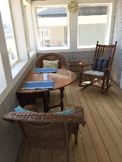 Downstairs porch. Table opens to seat 6.