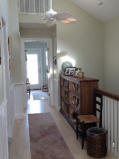 Upstairs hallway; cathedral ceiling, 2 ceiling fans, looking toward back BRs.