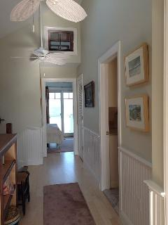 Up stairs hallway facing master BR and ocean. Bathroom to right.