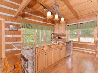 Kitchen with granite countertops, island seats 6