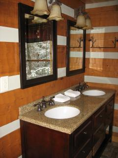Downstairs bath with double sinks, granite vanity