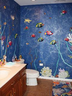 Lower level bath has a dressing area, stand up shower and a fun mural!