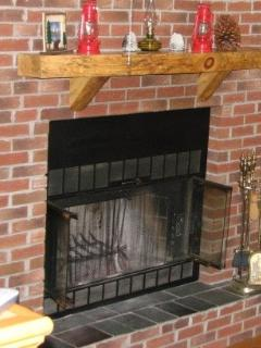 Fireplace with hand made rustic mantel