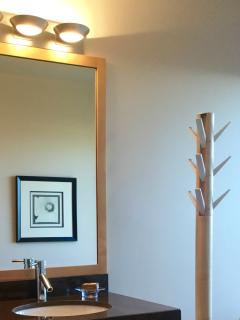 Lovely maple framed mirror, towel tree, and more Italian granite. And in-floor heat to warm toes...