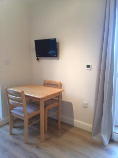 Dining area seats up to 4, and has underfloor heating, wifi and freeview TV. Door out to garden.