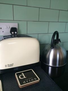 The kitchen is fully equipped with cooker, hob, fridge and microwave, plus crockery and cookware