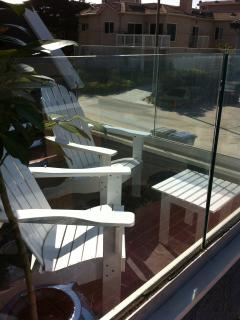 Adirondack Chairs with glass for a unobstructed view to the beach.