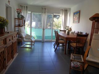 Lounge/dining room with balcony overlooking garden
