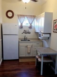 kitchen with sink, full size refrigerator, microwave, double electric burner, and coffee pot