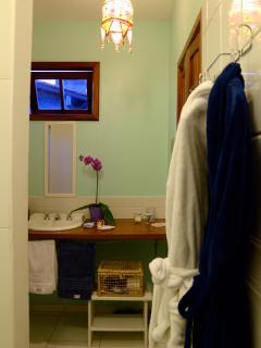 bath and face towels, bath robes, basic toiletries, hair dryer.