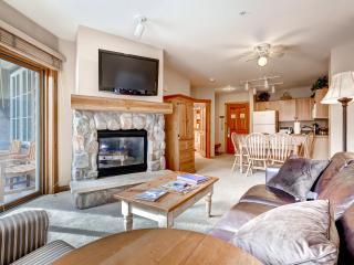 Beautiful living area w/ Stone fireplace & TV