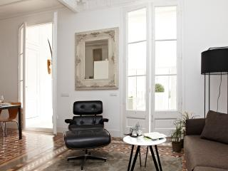 stylish furniture and classic mirror in the leaving room, behind there is the gallery