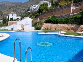 Large Communal Pool with sunbathing area, sun loungers, indoor and outdoor showers