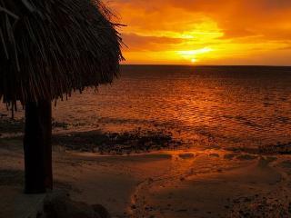 Beach side with sunset bungalow, Haapiti