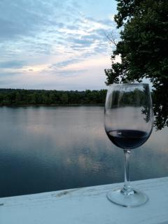Sip and watch the sunset color the River and sky on your private balcony.