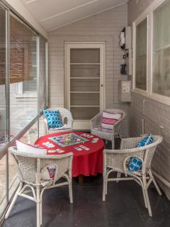 Relax in the sunroom at Benson House
