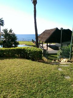 View of pool, pool bar & sea from private garden