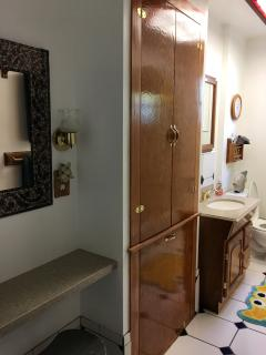 Side view of bathroom with vanity area