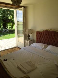 Double bedroom with south facing French doors - just a few steps to the sunbed!