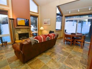 Living room features a comfy leather sofa, 42' HDTV, full size murphy bed and floor to ceiling windows allowing natural light to fill the room.