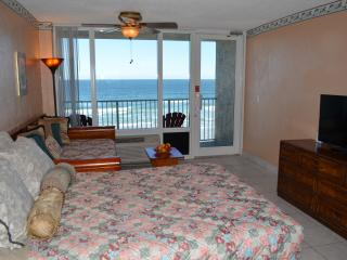Queen bed and 2 single beds, flatscreen TV.