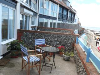 Your private patio area overlooking the promenade and the sea,